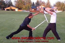 weapons experts using sword and buckler in modern day combat