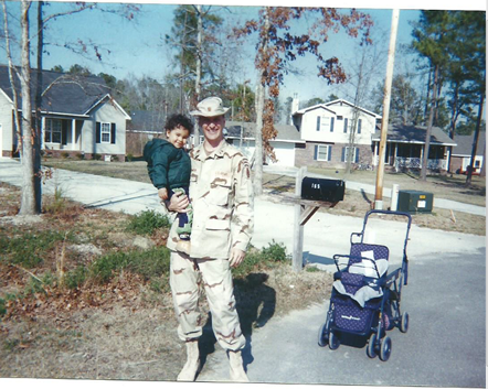 A younger Lt Col S Brower with son in Desert camo