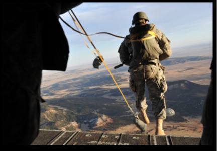 Picture of a soldier jumping out the back of a plane