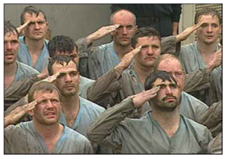 Picture of a bedraggled group of men saluting